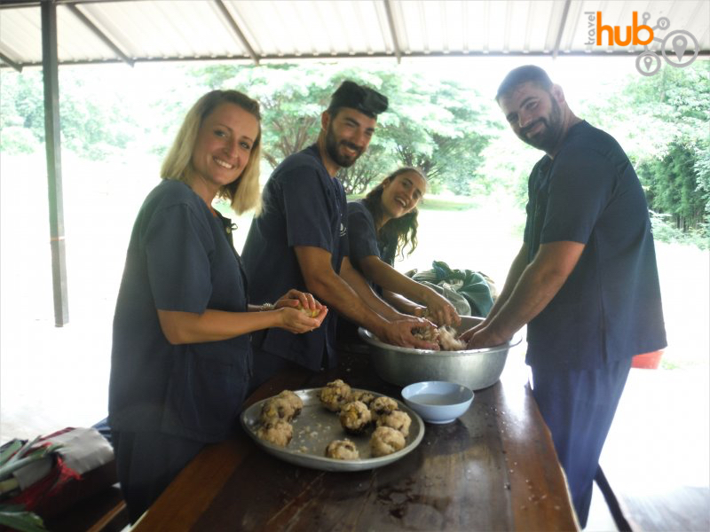 Preparing sticky rice medicine balls for the elephants
