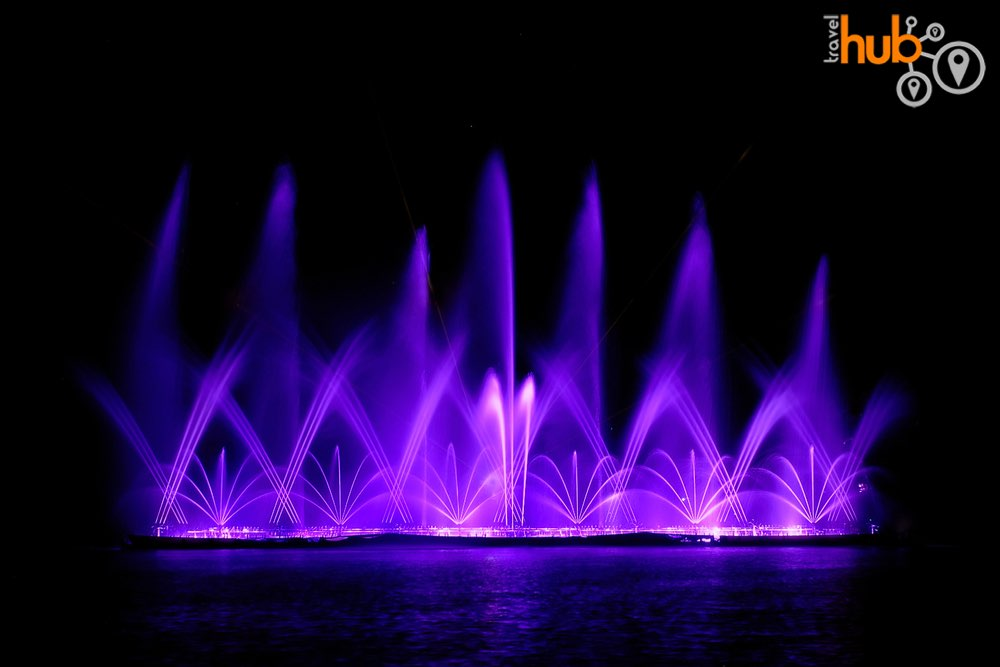 Enjoy the  fountain and laser show on the central lake