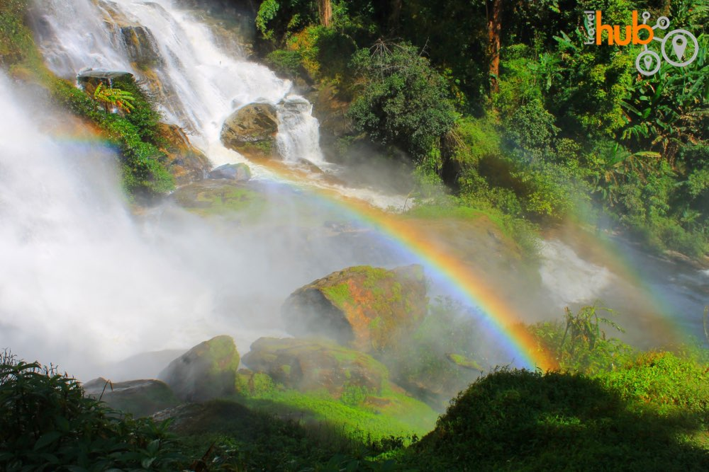 on a sunny morning a rainbow will form in the spray at wachiritharn waterfall