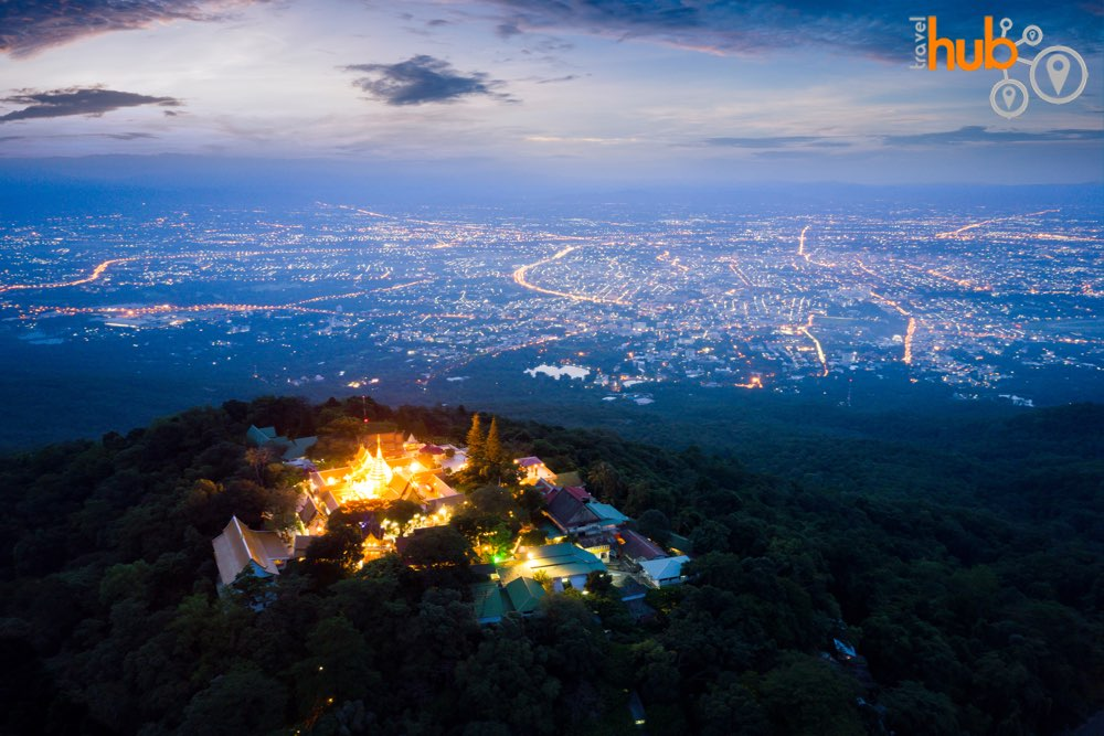 Its dusk at Doi suthep and you can see the city lights below