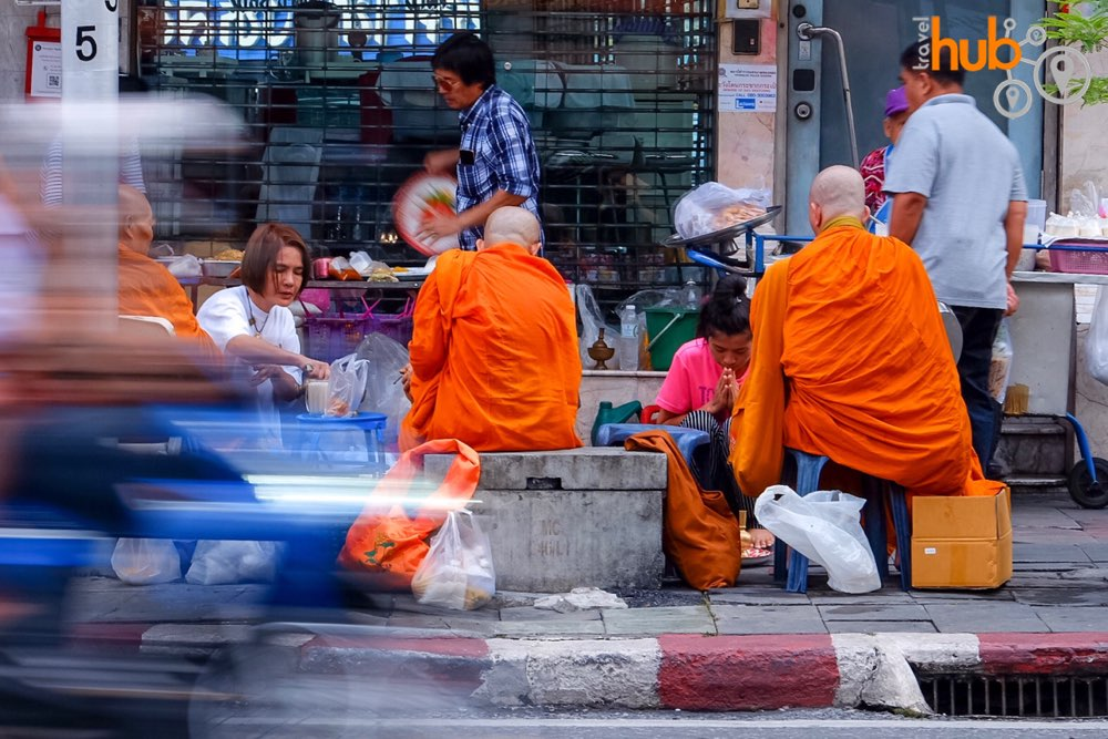 Chiang Mai Gate Market is a popular spot for alms giving to the monks