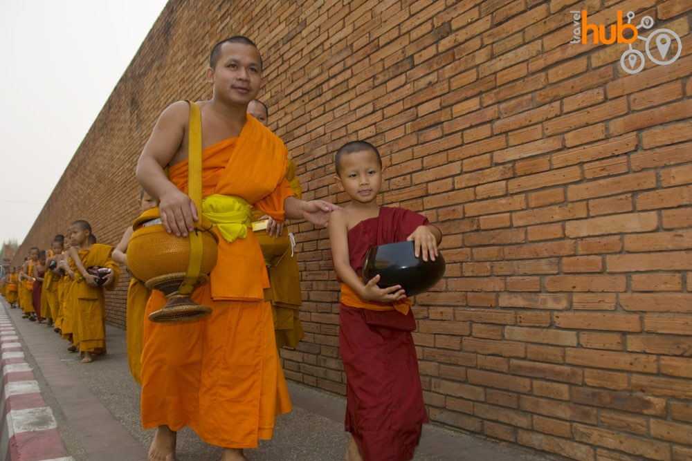 The monks on their early morning alms rounds