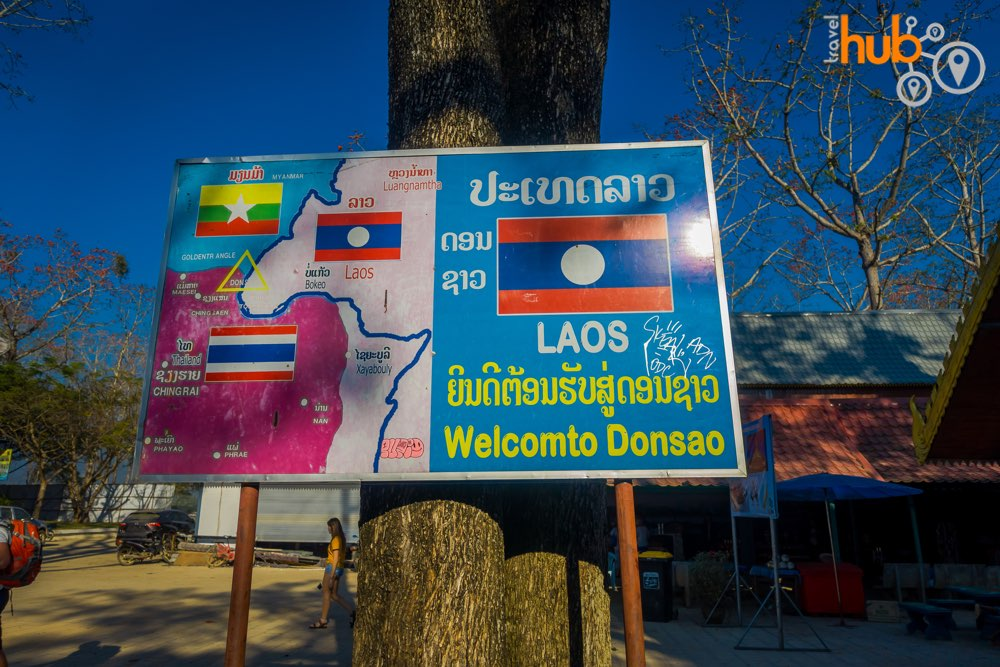 Take the boat trip option to Laos and visit a small market